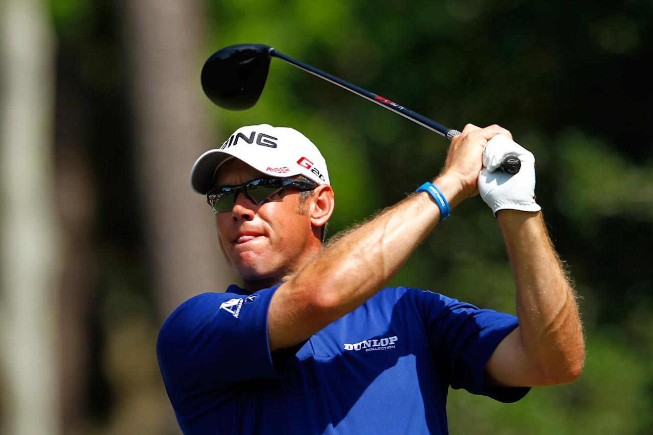 PONTE VEDRA BEACH, FL - MAY 10:  Lee Westwood of England hits his tee shot on the ninth hole during the first round of THE PLAYERS Championship held at THE PLAYERS Stadium course at TPC Sawgrass on May 10, 2012 in Ponte Vedra Beach, Florida.  (Photo by Mike Ehrmann/Getty Images)