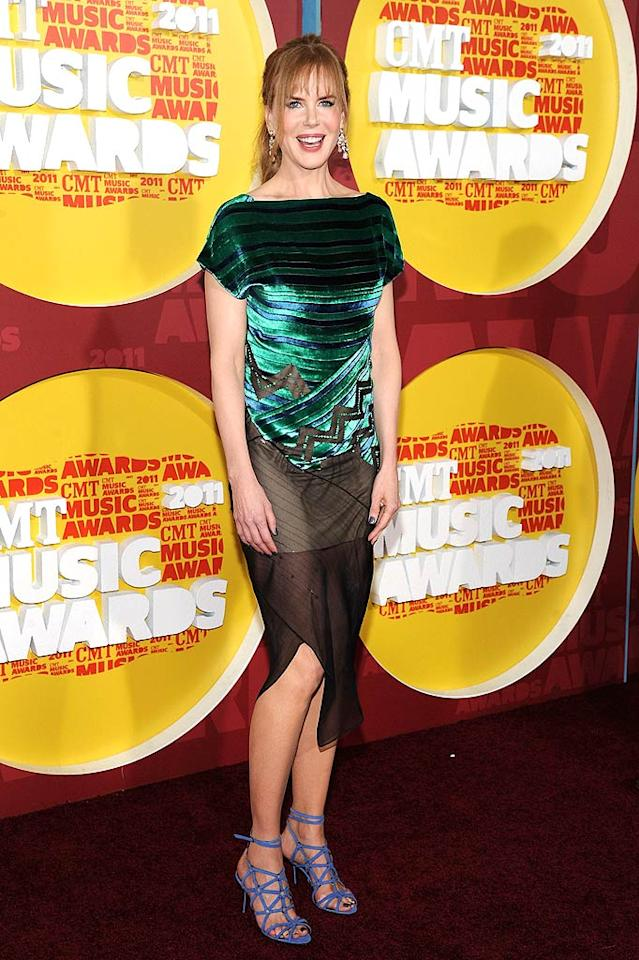 """And last, but certainly not least ... Nicole Kidman, who was undoubtedly the worst-dressed woman in attendance at the 2011 CMT Music Awards thanks to her velvet-and-chiffon Proenza Schouler bomb and periwinkle Pierre Hardy sandals. Yikes!   Follow What Were They Thinking?! creator, <a href=""""http://bit.ly/lifeontheMlist"""" target=""""new"""">Matt Whitfield</a>, on Twitter! Mike Coppola/<a href=""""http://www.wireimage.com"""" target=""""new"""">WireImage.com</a> - June 8, 2011"""