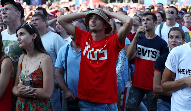 Soccer Football - World Cup - Group A - Russia vs Uruguay - Fan's zone, Sochi, Russia June 25, 2018 Russian fans react during the match. REUTERS/Hannah McKay