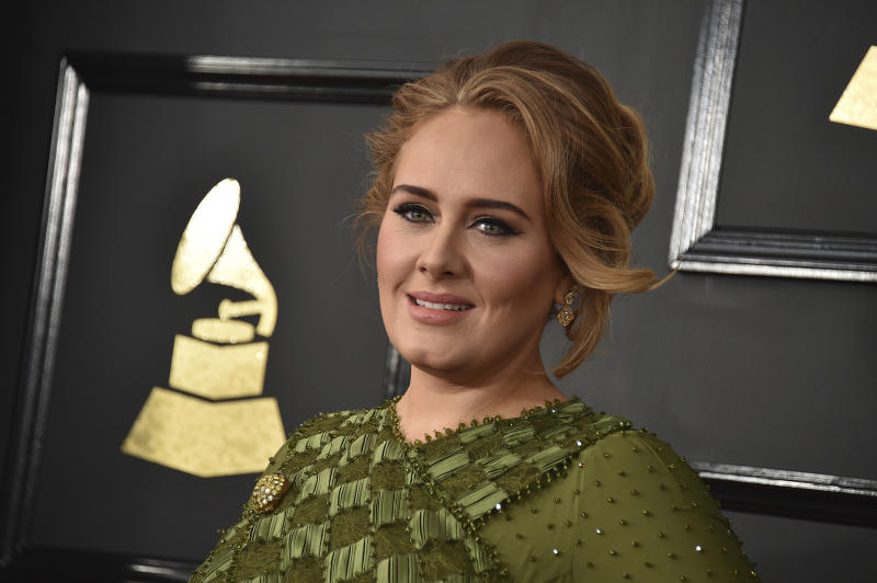 "FILE - In this Feb. 12, 2017, file photo, Adele arrives at the 59th annual Grammy Awards at the Staples Center in Los Angeles. Adele saluted Emma Stone and ""Moonlight's"" Oscar wins by giving thumbs up in an Instagram photo on Feb. 27, 2017. (Photo by Jordan Strauss/Invision/AP, File)"