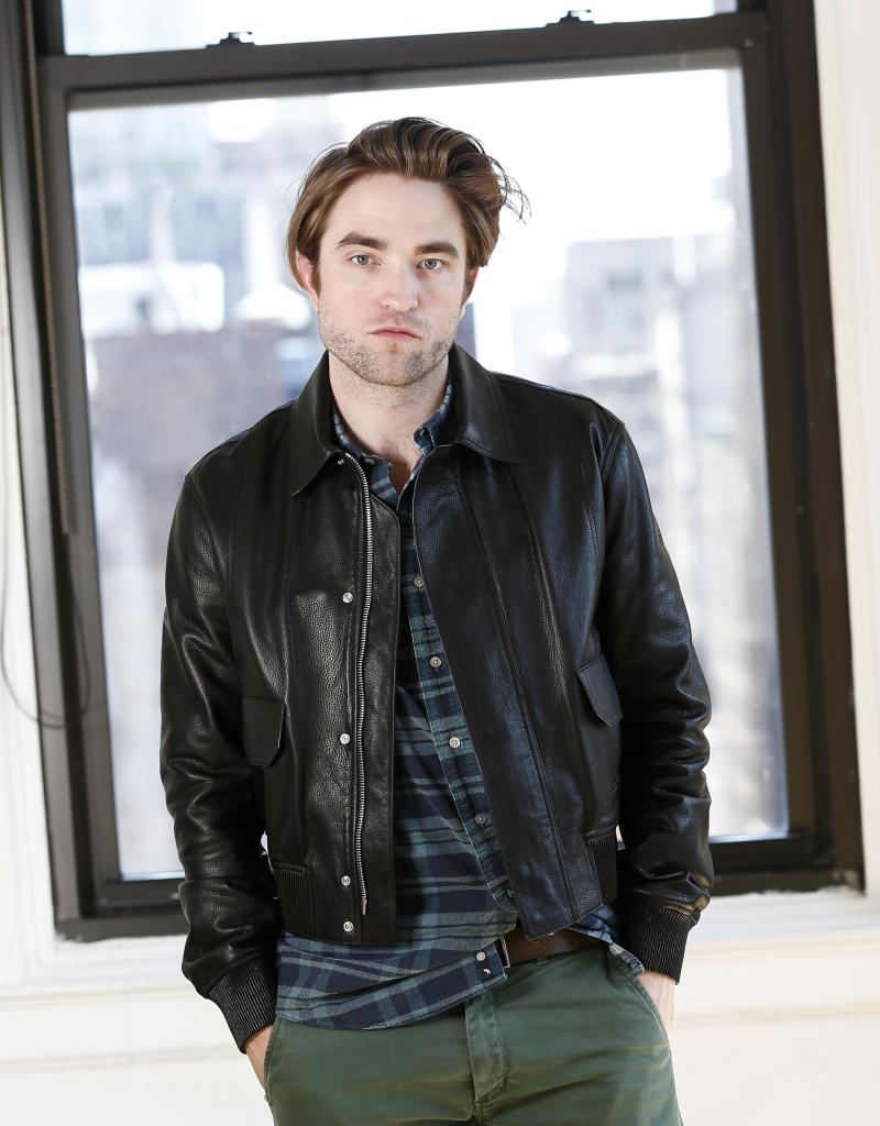 "This April 4, 2019 photo shows actor Robert Pattinson posing for a portrait to promote his film, ""High Life"" in New York. (Photo by Brian Ach/Invision/AP)"