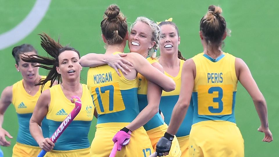 Hockeyroos players are seen here hugging at the Rio Games in 2016.