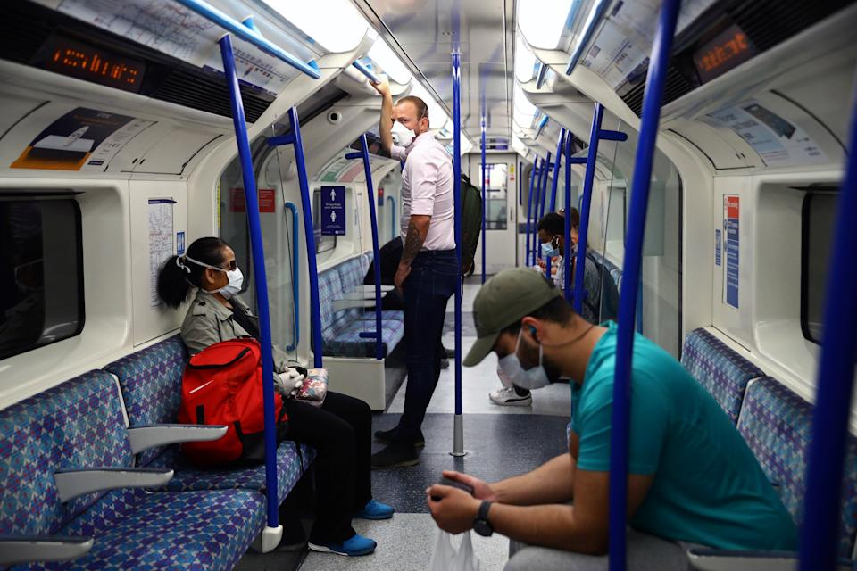 Passengers wearing face masks travel on the Victoria line tube, amid the spread of the coronavirus disease (COVID-19) in London, Britain June 15, 2020. REUTERS/Hannah McKay