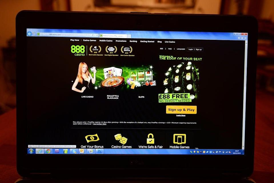 A person accesses the 888casino.com gambling website. 888 lifted its earnings and sales targets (John Stillwell/PA) (PA Archive)