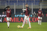 AC Milan's Brahim Diaz, left and his teammate AC Milan's Ante Rebic stand after Parma's Hernani scored his side's first goal during a Serie A soccer match between AC Milan and Parma, at the San Siro stadium in Milan, Italy, Sunday, Dec. 13, 2020. (AP Photo/Luca Bruno)