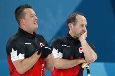 Curling - Pyeongchang 2018 Winter Olympics - Men's Semi-final - Canada v U.S. - Gangneung Curling Center - Gangneung, South Korea - February 22, 2018 - Lead Ben Hebert and second Brent Laing of Canada react during the game. REUTERS/Phil Noble