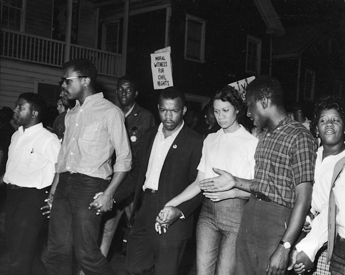 Civil Rights leaders, including future Congressman John Lewis (third left) and Gloria Richardson (third right), chair of the Cambridge Non-Violent Action Committee, links hands with others as they march in protest of a scheduled speech by the pro-segregationist Alabama governor, George Wallace, Cambridge, Maryland, May 1964. (Photo by Francis Miller/The LIFE Picture Collection via Getty Images) (Photo: Francis Miller via Getty Images)