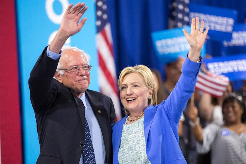 Bernie Sanders endorses presumptive Democratic presidential candidate Hillary Clinton at a rally in Portsmouth, New Hampshire on July 23, 2016 (AFP Photo/Justin Saglio)