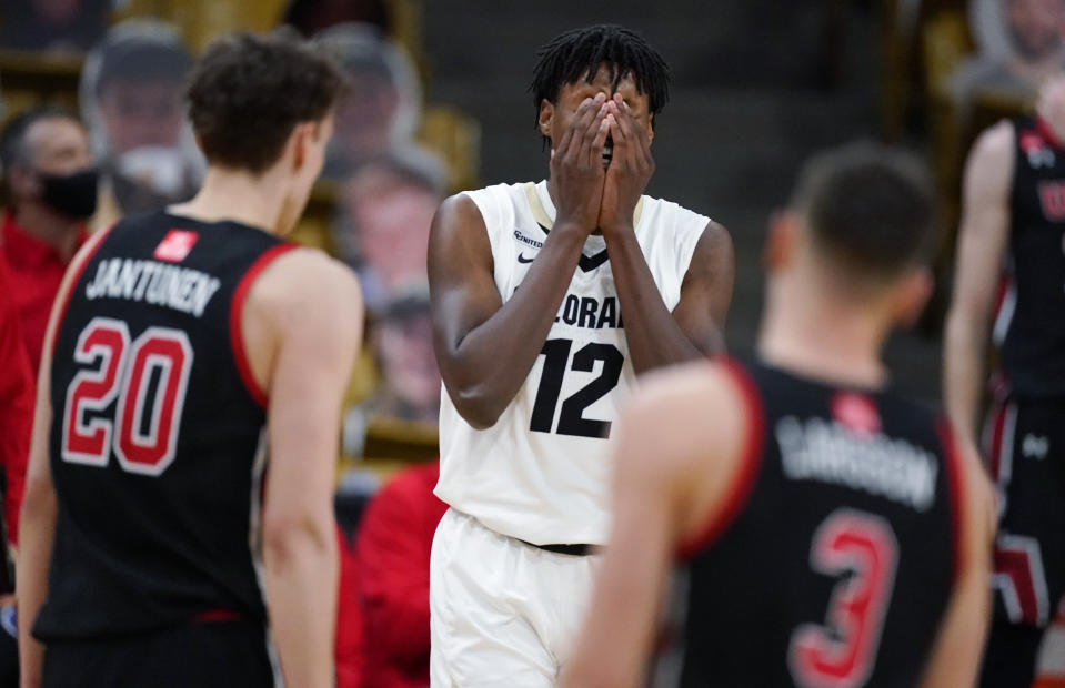 Colorado forward Jabari Walker, center, reacts after being called for a foul as Utah forward Mikael Jantunen, front left, and guard Pelle Larsson look on in the second half of an NCAA college basketball game Saturday, Jan. 30, 2021, in Boulder, Colo. Utah won 77-74. (AP Photo/David Zalubowski)