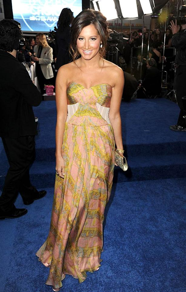 """Overly bronzed """"Hellcats"""" star Ashley Tisdale must think it's summertime. Her dress is undoubtedly cute, but doesn't it seem a tad out of season for an awards show in January? Jeff Kravitz/<a href=""""http://www.filmmagic.com/"""" target=""""new"""">FilmMagic.com</a> - January 5, 2011"""