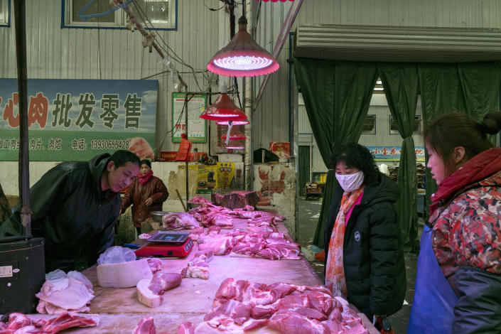 Cuts of raw meat for sale at a market in Langfang, China, Jan. 23, 2020. (Giulia Marchi/The New York Times)