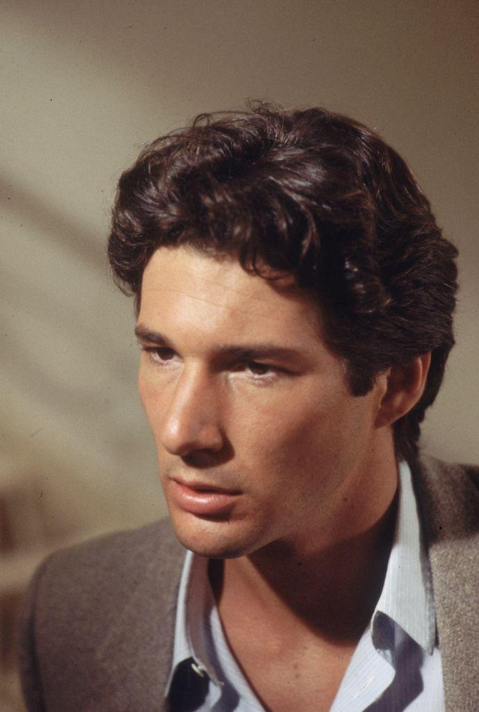 <p>As a young actor, Richard Gere had a thick mane of dark hair, which he sported in films like <em>American Gigolo </em>and <em>Officer and a Gentleman. </em></p>
