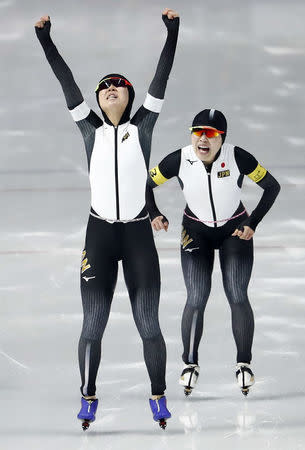 Speed Skating - Pyeongchang 2018 Winter Olympics - Women's Team Pursuit competition finals - Gangneung Oval - Gangneung, South Korea - February 21, 2018 - Ayano Sato and Miho Takagi of Japan celebrate after winning a gold medal. REUTERS/Damir Sagolj