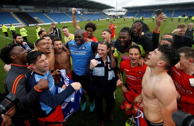 """Soccer Football - League Two - Chesterfield v Wycombe Wanderers - Proact Stadium, Chesterfield, Britain - April 28, 2018 Wycombe Wanderers players celebrate after winning promotion Action Images/Paul Childs EDITORIAL USE ONLY. No use with unauthorized audio, video, data, fixture lists, club/league logos or """"live"""" services. Online in-match use limited to 75 images, no video emulation. No use in betting, games or single club/league/player publications. Please contact your account representative for further details."""