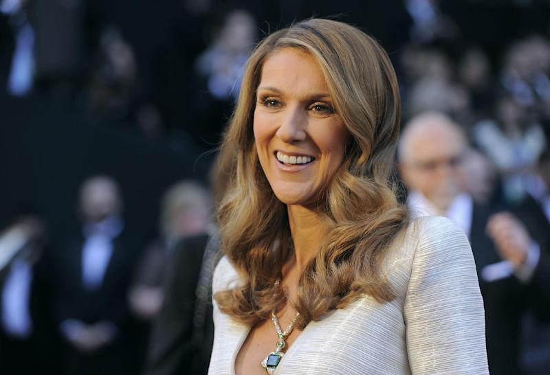 """FILE - In this Feb. 27, 2011 file photo, singer Celine Dion arrives before the 83rd Academy Awards, in the Hollywood section of Los Angeles. CBS says Dion will host a holiday special spotlighting adoption. The network said Dion also will perform, along with Ne-Yo, Chris Young and others, on the 15th annual """"A Home for the Holidays,"""" special that airs on Dec. 18, 2013. (AP Photo/Chris Pizzello, File)"""