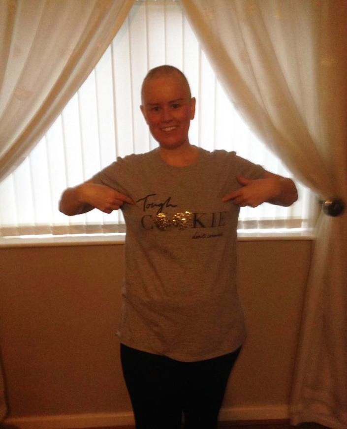 The chemotherapy caused the mum of two to lose all her hair [Photo: Joanne Carr/SWNS]