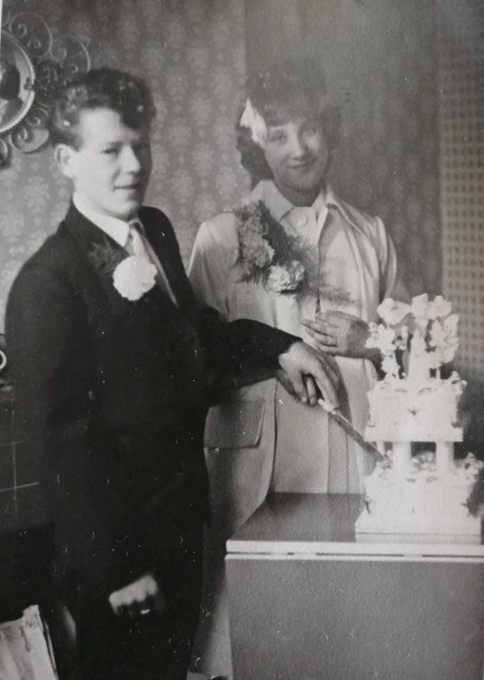 Lynne Woolliss and hubby Bert wedding day, They married on July 17, 1961 when she was seven months pregnant with her first son John, with just six people in attendance. See SWNS story SWLEanniversary; A bride who married the love of her of life on her 16th birthday as it was the earliest they could wed has celebrated 60 years of bliss with her husband.  Lynne Woolliss, 76, and hubby Bert, 77, are two of the youngest people in the country to mark their diamond wedding anniversary having met as teenagers. The couple celebrated their diamond anniversary at their home in Cleethorpes, Lincs., on Saturday (July 17) surrounded by their family and were 'chuffed' to receive a card from the Queen.  They met way back in 1959 when he kept looking at her when they were at school and she 'wondered if something was wrong with him'.