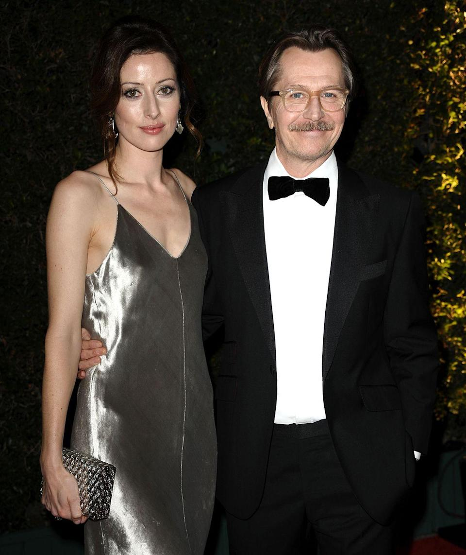 """<p>British actor Gary Oldman has had <a href=""""https://www.distractify.com/p/celebrities-multiple-marriages"""" rel=""""nofollow noopener"""" target=""""_blank"""" data-ylk=""""slk:five marriages"""" class=""""link rapid-noclick-resp"""">five marriages</a>, and is currently married to writer Gisele Schmidt. He was previously married to actress Lesley Manville from 1987 to 1990, immediately followed by a two-year marriage to actress Uma Thurman. He then married photographer Donya Fiorentino in 1997 and divorced in 2001. And his fourth marriage, to British singer Alexandra Edenborough, was from 2008 to 2015. </p>"""