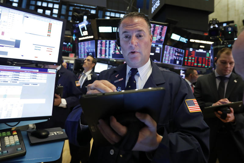 Trader Jonathan Corpina works on the floor of the New York Stock Exchange, Tuesday, Oct. 8, 2019. Stocks are opening lower on Wall Street as tensions rose between Washington and Beijing just ahead of the latest round of trade talks. (AP Photo/Richard Drew)