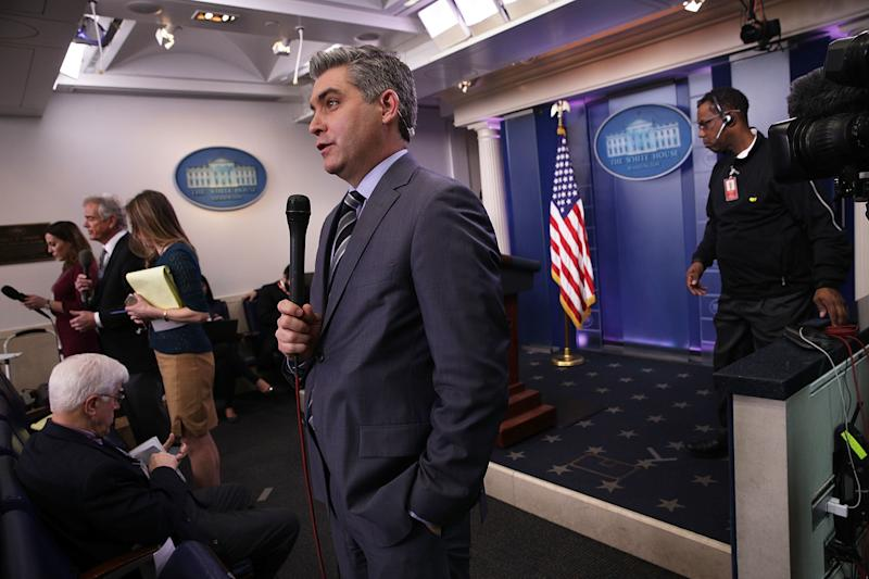 CNN senior White House correspondent Jim Acosta participates in a stand-up shot as he reports after the White House daily briefing on Feb. 7. (Alex Wong via Getty Images)