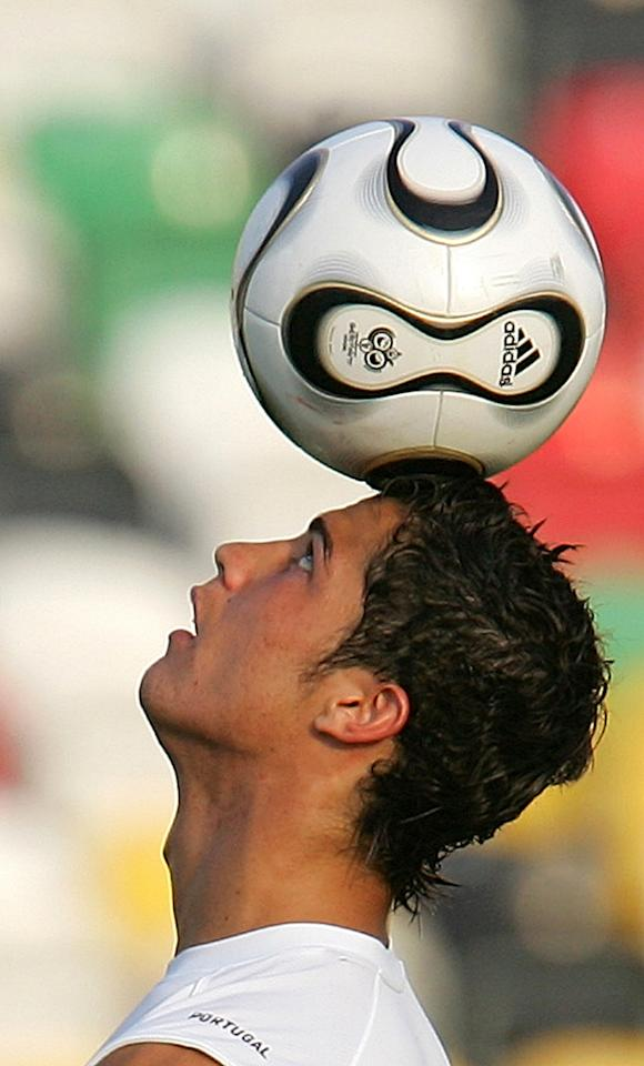 "** FILE ** Portugal national soccer player Cristiano Ronaldo balances a soccer ball on his head during a training session Tuesday, May 30, 2006, in Evora, southern Portugal. The ball that will be used at the World Cup in Germany, shown in this photo, probably will be praised as much as it is disparaged. Strikers and midfielders love it. Goalkeepers hate it. The ""Teamgeist"" (team spirit) ball is the last in a line of 10 World Cup balls by Adidas. It features the latest in design and technology, promising a more accurate flight. (AP Photo/Paulo Duarte)"