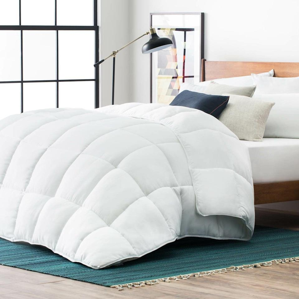 """<h2>Joss & Main Microfiber Down Alternative Comforter</h2><br><strong>Deal: 19% off</strong><br>Another bedding favorite comes from Wayfair's chic sister site, Joss & Main, which is also having its own Way Day fun. This down alternative comforter stole the hearts of readers because of its hypoallergenic materials, fluffy stuffing, and its affordable price tag. <br><br><em>Shop</em><strong><em> <a href=""""http://jossandmain.com"""" rel=""""nofollow noopener"""" target=""""_blank"""" data-ylk=""""slk:Joss & Main"""" class=""""link rapid-noclick-resp"""">Joss & Main</a></em></strong><br><br><strong>Joss and Main</strong> Microfiber Down Alternative Comforter, $, available at <a href=""""https://go.skimresources.com/?id=30283X879131&url=https%3A%2F%2Fwww.jossandmain.com%2Fbedding-bath%2Fpdp%2Fmicrofiber-down-alternative-comforter-anew2685.html"""" rel=""""nofollow noopener"""" target=""""_blank"""" data-ylk=""""slk:Joss and Main"""" class=""""link rapid-noclick-resp"""">Joss and Main</a>"""