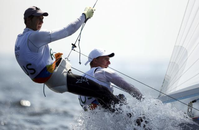 2016 Rio Olympics - Sailing - Preliminary - Men's Two Person Dinghy - 470 - Race 8/9/10 - Marina de Gloria - Rio de Janeiro, Brazil - 16/08/2016. Pavel Sozykin (RUS) of Russia and Denis Gribanov (RUS) of Russia compete. REUTERS/Benoit Tessier FOR EDITORIAL USE ONLY. NOT FOR SALE FOR MARKETING OR ADVERTISING CAMPAIGNS.