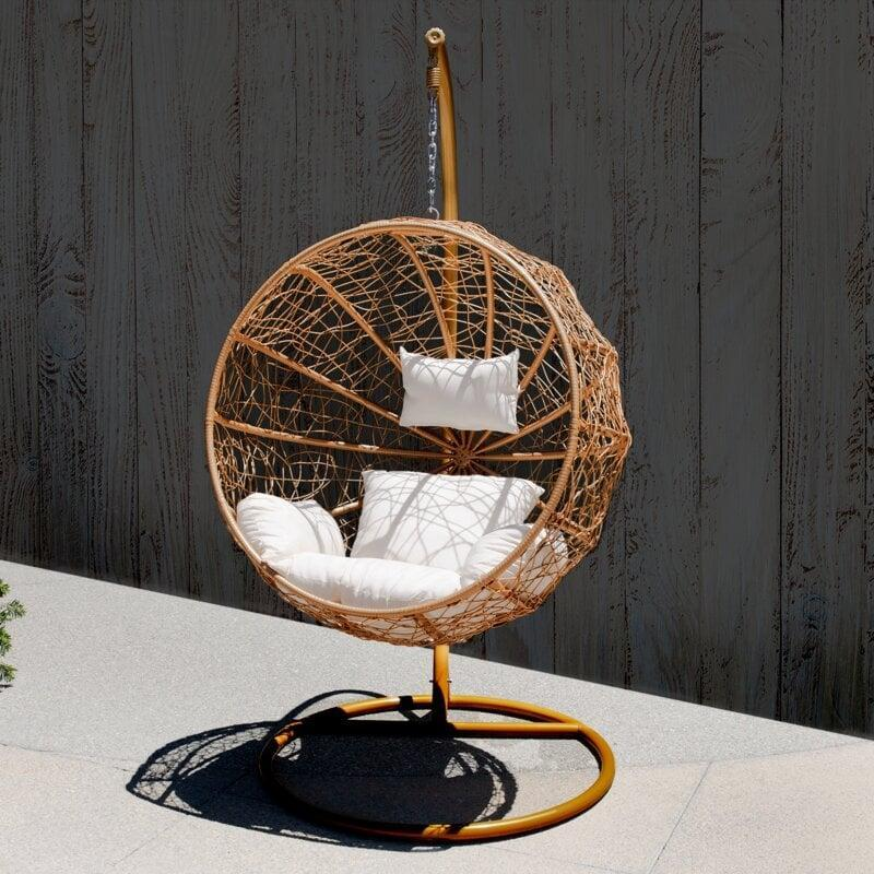 <p>This <span>AllModern Muller Swing Chair with Stand</span> ($630, originally $681) looks like so much fun.</p>
