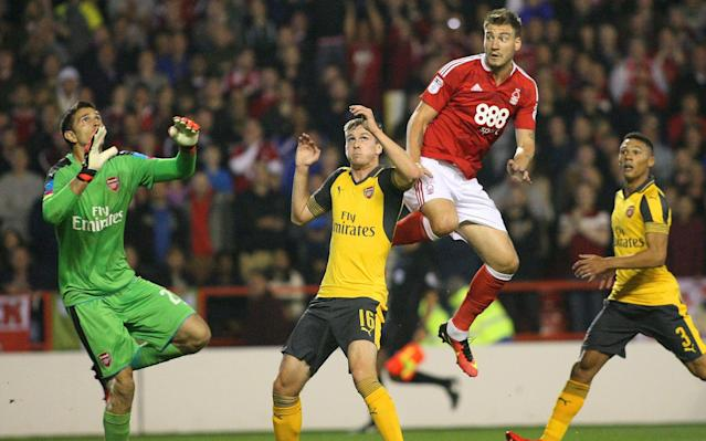 <span>Emiliano Martinez (L) in action for Arsenal against Nottingham Forest</span>