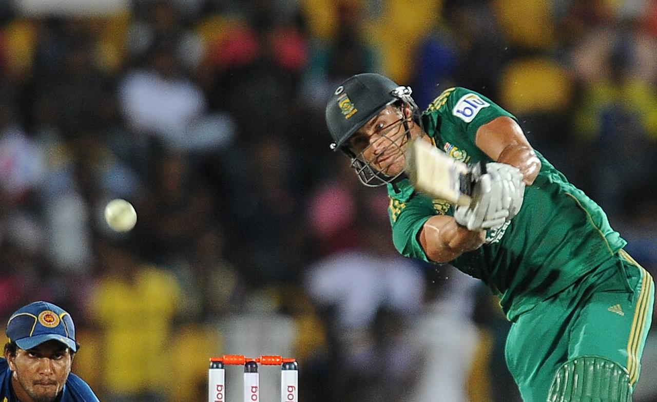 South African cricket captain Faf du Plessis plays a shot during the third and final Twenty20 cricket match between Sri Lanka and South Africa at the Suriyawewa Mahinda Rajapakse International Cricket Stadium in the southern district of Hambantota on August 6, 2013. AFP PHOTO/ LAKRUWAN WANNIARACHCHI