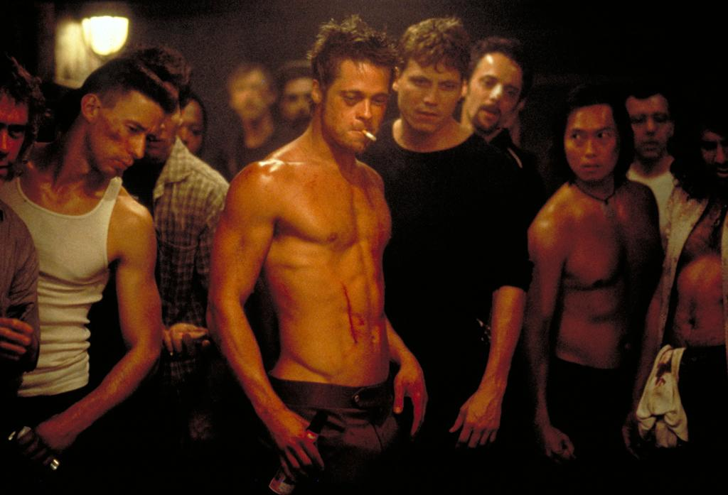 """<a href=""""http://movies.yahoo.com/movie/1800018964/info"""">Fight Club</a> (1999): The first rule of Brad Pitt is, it's impossible not to talk about Brad Pitt. He's larger than life here, mythological almost, as Tyler Durden, the leader of the secret fight club and the key to Edward Norton's salvation -- or so he initially thinks. Sinewy and swaggering, Pitt radiates sexy masculinity in an almost primal way. The fact that he also challenges the men who follow him on emotional and psychological levels makes him not just charismatic but downright frightening. This is one of several films Pitt has made with director David Fincher -- and you might put """"Se7en"""" or """"The Curious Case of Benjamin Button"""" on your list of his top performances -- but this is the one that stands out most for me."""