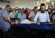 Israelis mourn during the funeral of Yigal Yehoshua, 56, who died after being beaten by suspected Arabs in the city of Lod