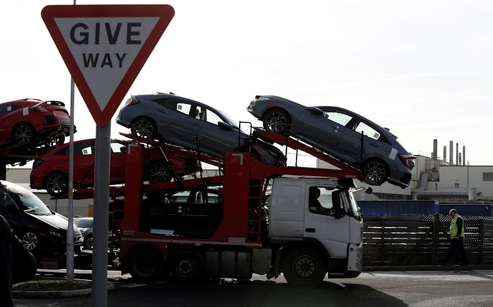 """A car transporter loaded with new Honda vehicles is driven out of the Honda manufacturing plant in Swindon, southwest England on February 19, 2019. - Honda announced Tuesday it would shut a major plant in Britain, putting 3,500 jobs at risk as the auto manufacturer became the latest Japanese firm to downsize operations as Brexit looms. The factory in Swindon, southwest England, is Honda's only EU plant and has produced the manufacturer's """"Civic"""" model for more than 24 years, with 150,000 units rolling off the line annually. (Photo by Adrian DENNIS / AFP)        (Photo credit should read ADRIAN DENNIS/AFP/Getty Images)"""