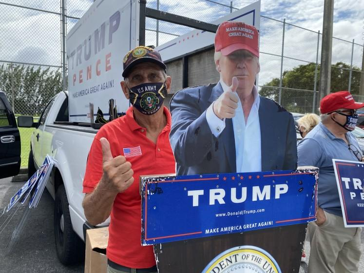 Julio Martinez, president of the Hialeah Republican Club stands outside of Hialeah John F Kennedy Library supporting President Trump.