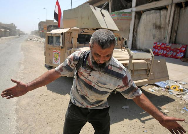 <p>An Iraqi man, who was injured in a suicide attack as people were escaping the Old City of Mosul, reacts as he arrives at a make-shift hospital on June 23, 2017. (Photo: Ahmad al-Rubaye/AFP/Getty Images) </p>