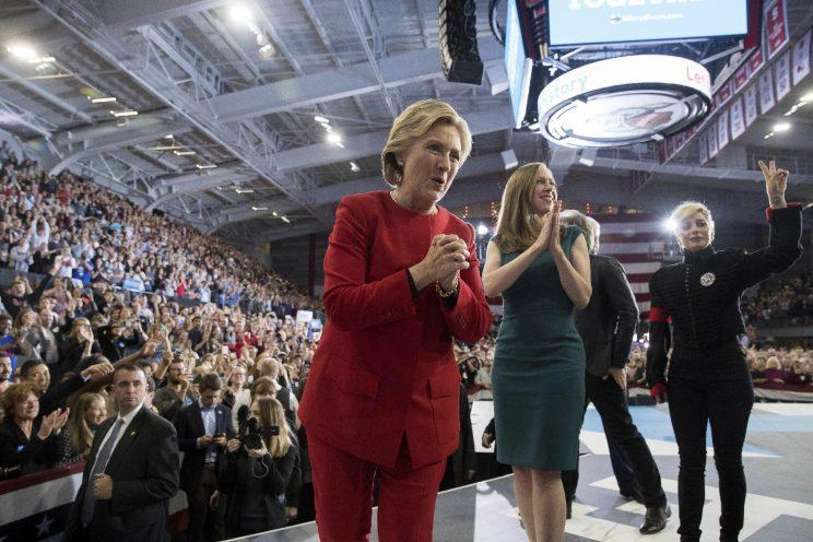 Hillary Clinton, Chelsea Clinton and musician Lady Gaga greet members of the audience after speaking at a midnight rally in Raleigh, N.C. (Photo: Andrew Harnik/AP)