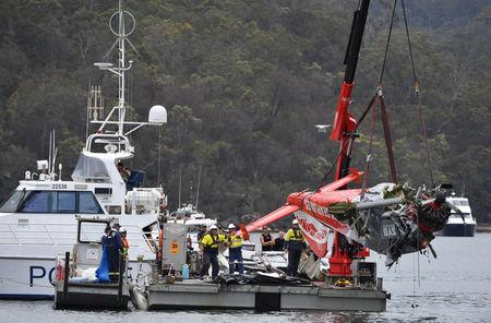 NSW police and salvage personnel recover the wreckage of a seaplane that crashed into Jerusalem Bay, north of Sydney, Australia, January 4, 2018. AAP/Mick Tsikas