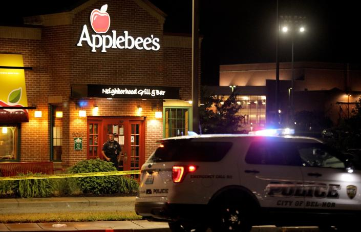 FILE - In this June 22, 2020, file photo, a police offer stands posted at the entrance of an Applebee's restaurant, in St. John, Mo., a suburb of St. Louis. A gunman opened fire inside the restaurant, killing one and injuring at least two others, police said. A new study released Monday, Feb. 1, 2021, by the National Commission on COVID-19 and Criminal Justice and Arnold Ventures looked at 34 U.S. cities and found a 30% spike in killings in 2020 compared to 2019. The study said the coronavirus pandemic and the racial injustice protests that followed George Floyd's death were factors. (Christian Gooden/St. Louis Post-Dispatch via AP File)