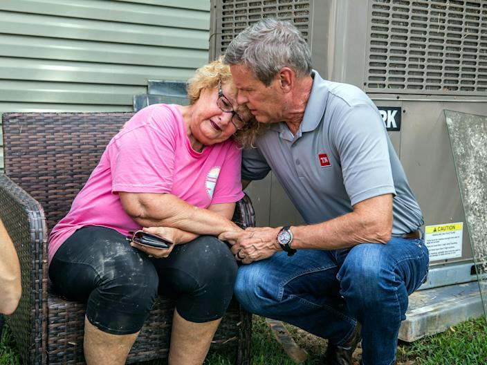 State governor Bill Lee comforts Shirley Foster, who had just learned a friend of hers had died in the flooding in Waverly, Tennessee, on Sunday 22 August 2021 (Alan Poizner/The Tennessean/AP)