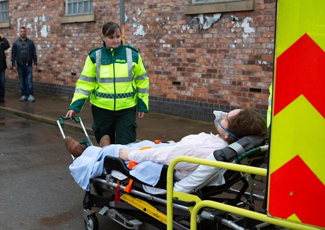 Maria Connor [SAMIA LONGCHAMBON] and Gary Windass [MIKEY NORTH] watch in horror as Ali Neeson [JAMES BURROWS] is loaded into an ambulance. (ITV Plc)
