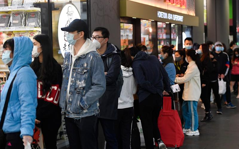 People line up to enter a supermarket hours before a citywide curfew is introduced in Melbourne - Erik Anderson/AAP Image via AP