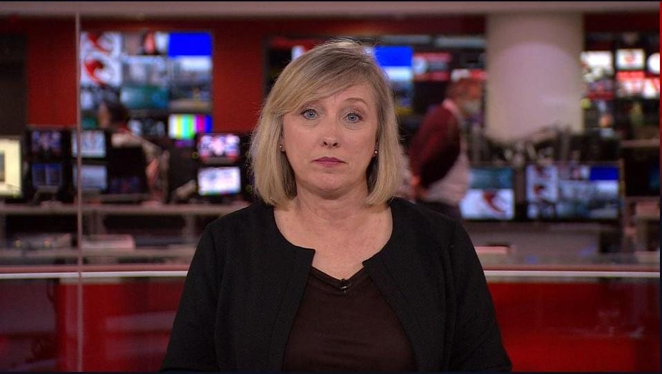 The journalist put on a black jacket and removed her jewellery (BBC)