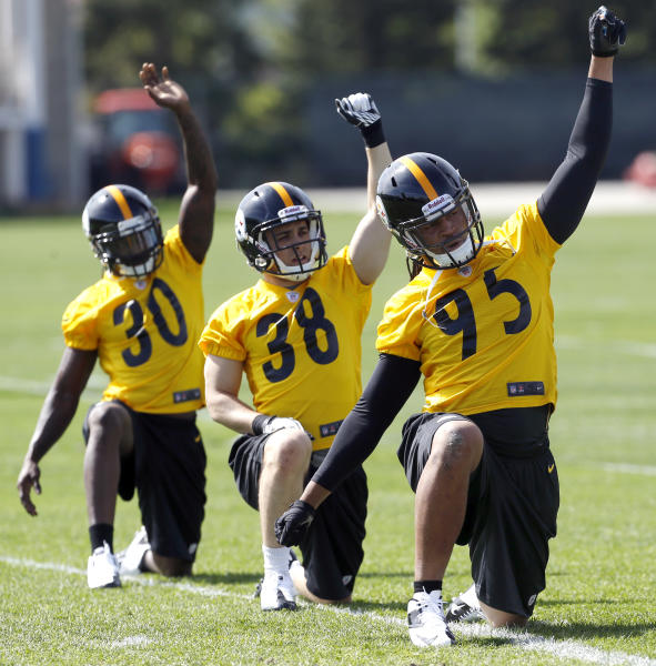 Pittsburgh Steelers first round draft choice, linebacker Jarvis Jones , front, out of Georgia, stretches with free agent safety Andrew Taglienetti (38) from Pittsburgh, and fifth round draft choice cornerback Terry Hawthorne from Illinois, during NFL football rookie minicamp on Friday, May 3, 2013 in Pittsburgh. (AP Photo/Keith Srakocic)