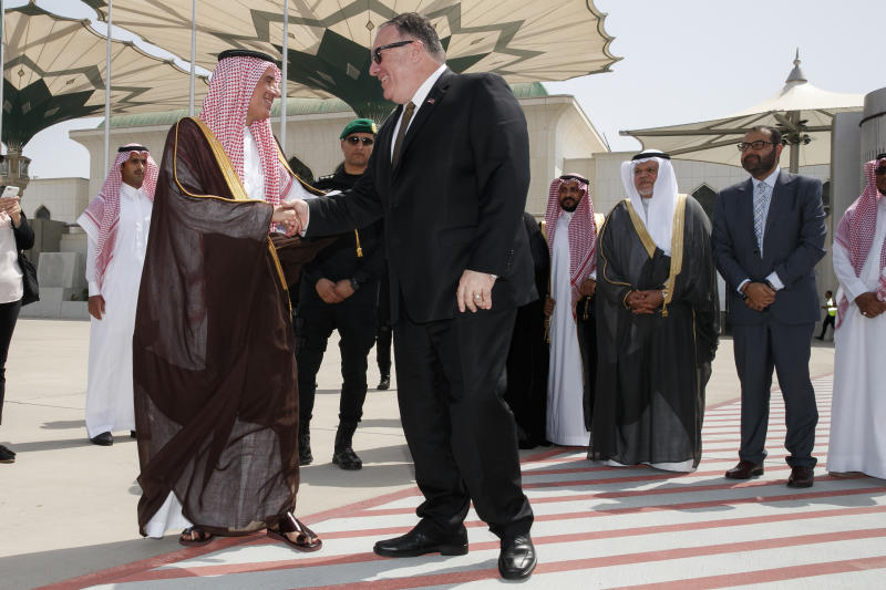 Secretary of State Mike Pompeo, center, shakes hands with Saudi Minister of State for Foreign Affairs Adel al Jubeir, as Pompeo departs Jeddah, Saudi Arabia, Monday, June 24, 2019, en route to Abu Dhabi. (AP Photo/Jacquelyn Martin, Pool)