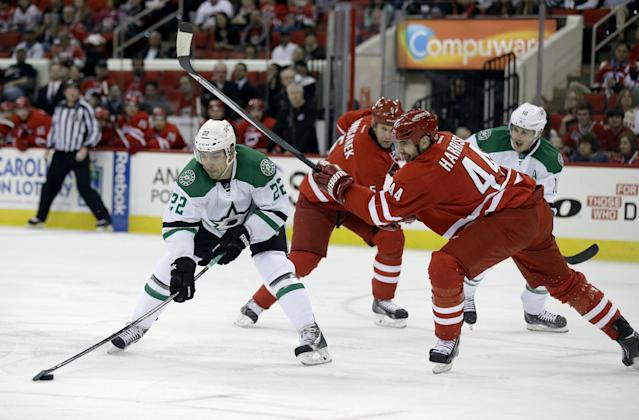 Carolina Hurricanes' Jay Harrison (44) defends Dallas Stars' Colton Sceviour (22) during the first period of an NHL hockey game in Raleigh, N.C., Thursday, April 3, 2014. (AP Photo/Gerry Broome)