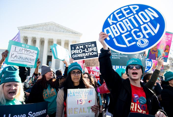 Pro-choice activists protest during a demonstration outside the Supreme Court in Washington, D.C. in March. (Photo by Saul Loeb/AFP via Getty Images)