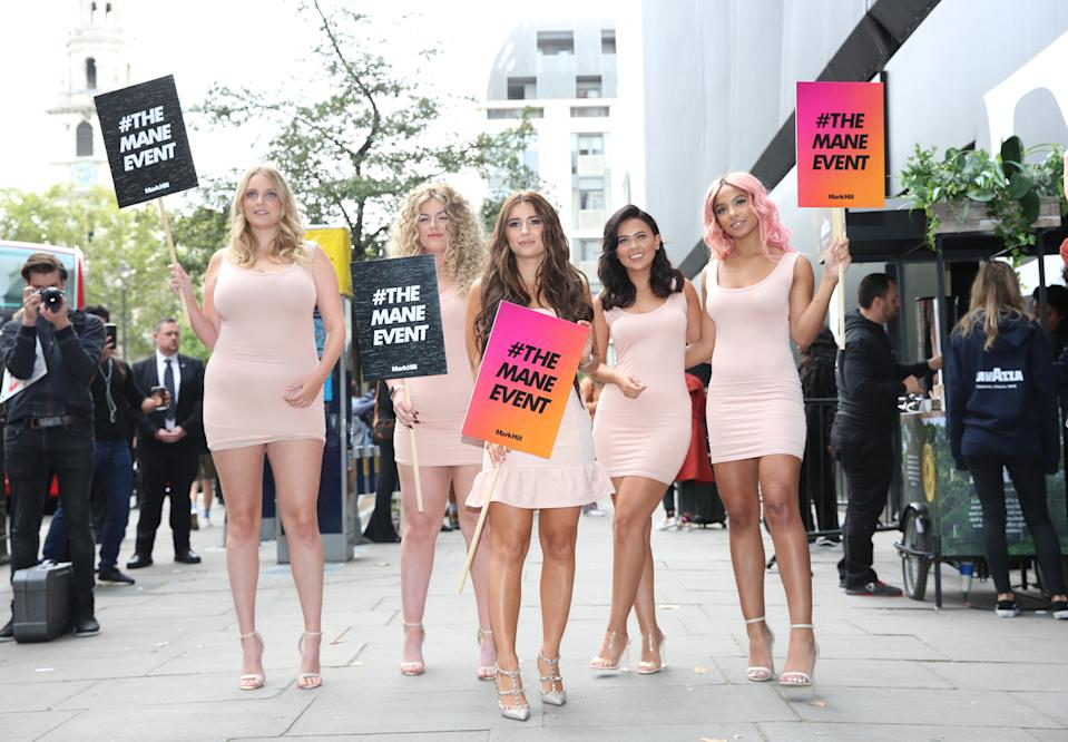 Dani Dyer (centre) helps to kick start Mark Hill's #TheManeEvent campaign outside LFW show space on the Strand in London during London Fashion Week SS19. (Photo by Isabel Infantes/PA Images via Getty Images)