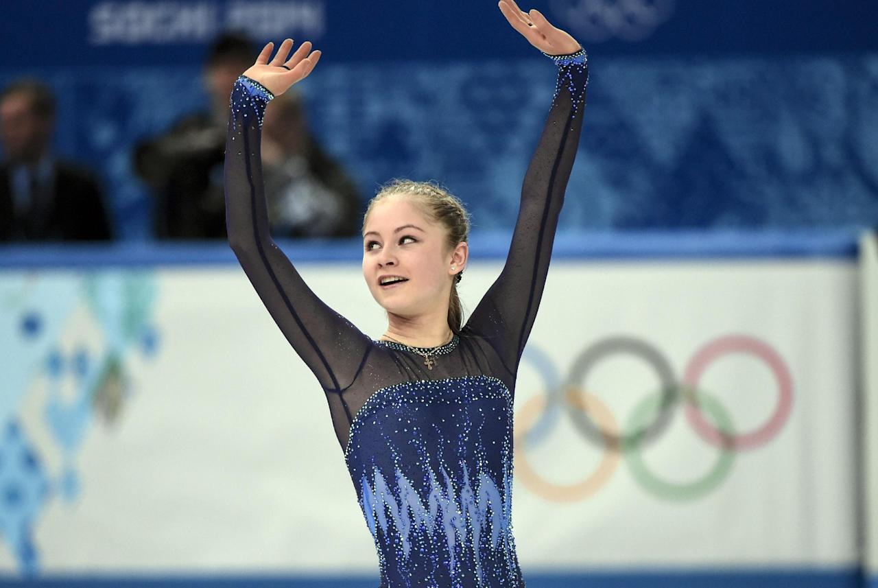 Yulia Lipnitskaya ,of Russia, waves after competing in the women's team short program figure skating competition at the Iceberg Skating Palace during the 2014 Winter Olympics, Saturday, Feb. 8, 2014, in Sochi, Russia. (AP Photo/The Canadian Press, Paul Chiasson)