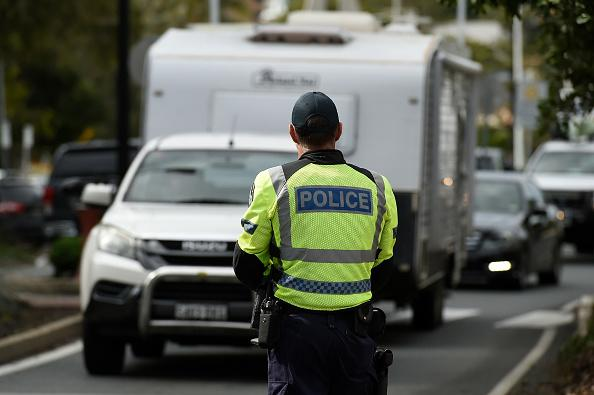 Police are seen at the Griffith Street checkpoint at Coolangatta, Australia.
