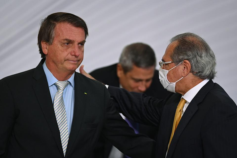 """BRASILIA, BRAZIL -DECEMBER09:  President of Brazil Jair Bolsonaro greets Minister of Economy of Brazil Paulo Guedes during the opening ceremony of the forum """"The Control in Combating Corruption"""" amidst the Coronavirus (COVID - 19) pandemic at Planalto Palace on December 09, 2020 in Brasilia.Brazil has over 6.674,000 confirmed positive cases of Coronavirus and has over 178,159 deaths. (Photo by Andre Borges/Getty Images)"""